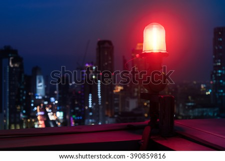 Closeup of an aircraft warning light on top of a highrise of building in night  time. for  safety concept - stock photo