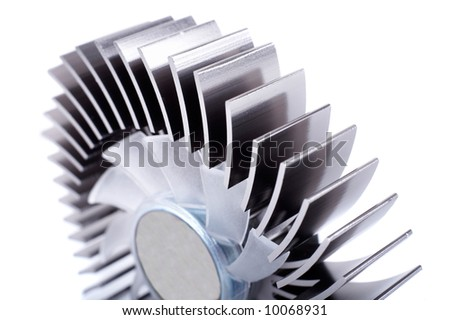 Closeup of an alluminium round cpu cooler isolated on white. Shallow depth of field. Focus on first plane. - stock photo