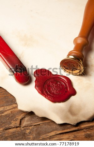 Closeup of an ancient parchment or diploma scroll with wax seal - stock photo