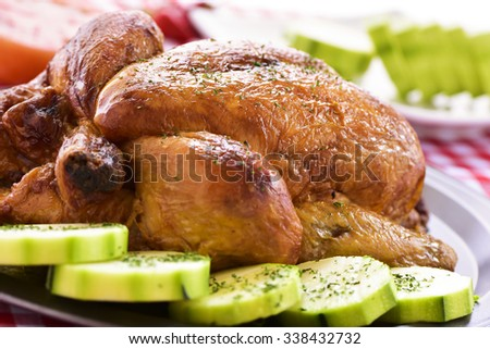 closeup of an appetizing roast turkey in a tray with vegetables - stock photo