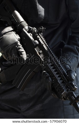 Closeup of an automatic M-4 rifle - stock photo