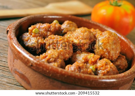 closeup of an earthenware bowl with a spanish meatballs stew - stock photo