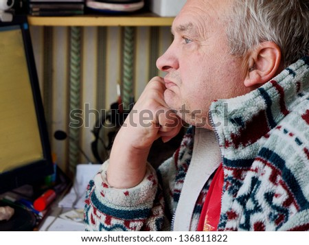 Closeup of an elderly man lost in thought , loneliness - stock photo