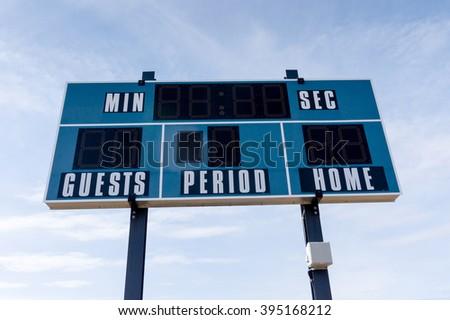Closeup of an electronic scoreboard at a local soccer cum football field. - stock photo