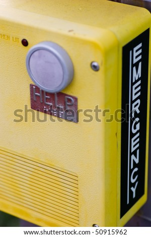 Closeup of an emergency call box, taken on a university campus. - stock photo