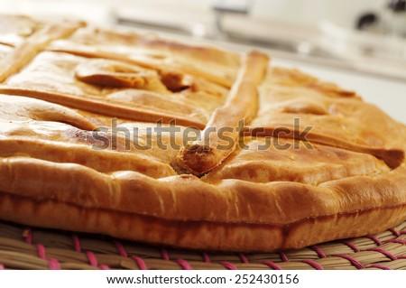 closeup of an empanada gallega, a savory stuffed cake typical of Galicia, Spain - stock photo