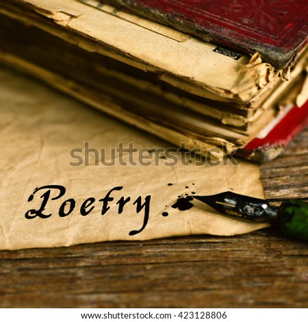 closeup of an old book, an old dip pen and a yellowish paper with the word poetry day written with black ink in it, on a rustic wooden table - stock photo