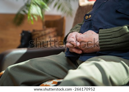 Closeup of an old man's hands joined - stock photo