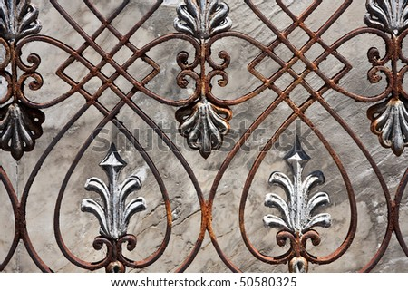 Closeup of an old metal fence. Grey Concrete Background - stock photo