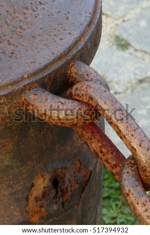 Closeup of an old rusty cannon and chain