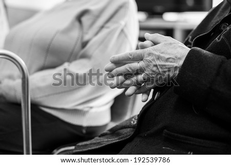 Closeup of an old woman's hands joined - stock photo