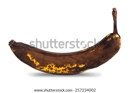 Closeup of an overripe banana with shadow, isolated on white background