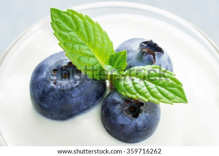Closeup of antioxidant superfood in a glass of yoghurt. - stock photo