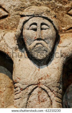 Closeup of antique statue from limestone of Jesus Christ - stock photo