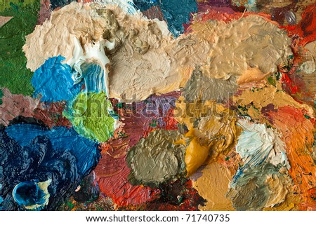 closeup of artists palette with mixed oil paint