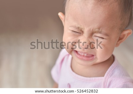 Closeup of asian baby girl crying