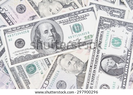 Closeup of assorted American banknotes - stock photo
