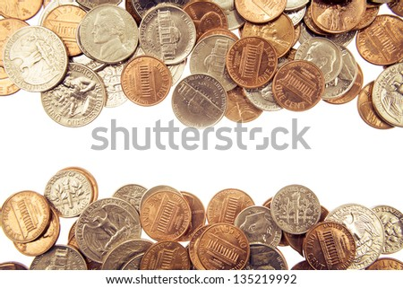 Closeup of assorted American coins on plain background. Copy space - stock photo