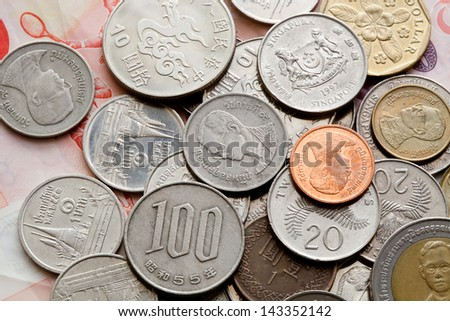 Closeup of assorted Asia coins - stock photo