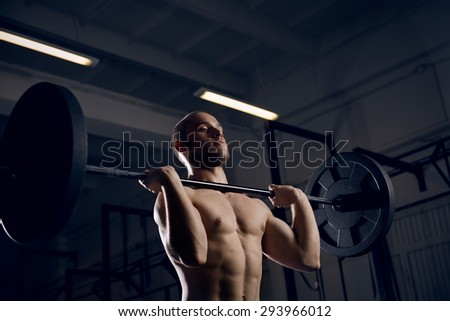 Closeup of athlete training snatch exercise with barbells - stock photo