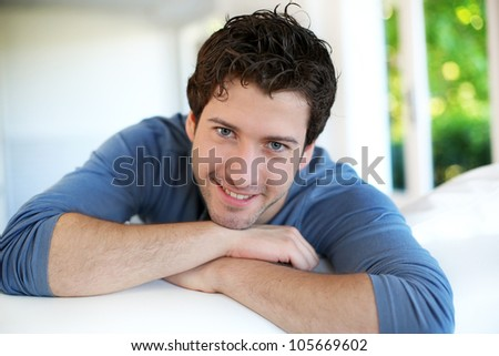 Closeup of attractive young man relaxing at home - stock photo
