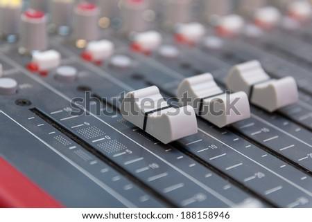 Closeup of audio mixing board - stock photo