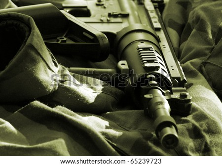 Closeup of automatic rifle. Focus in the middle of frame.