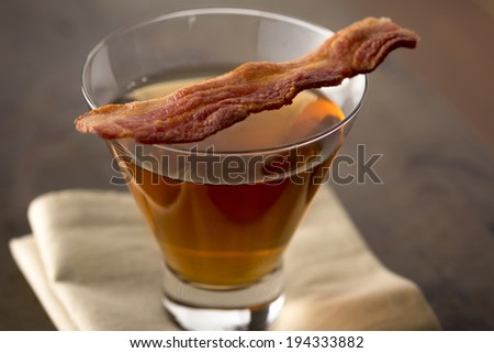 Closeup of bacon whiskey cocktail - stock photo