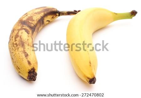 Closeup of bananas - fresh and overripe. Isolated on white background - stock photo