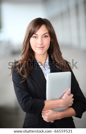 Closeup of beautiful businesswoman with electronic tablet - stock photo