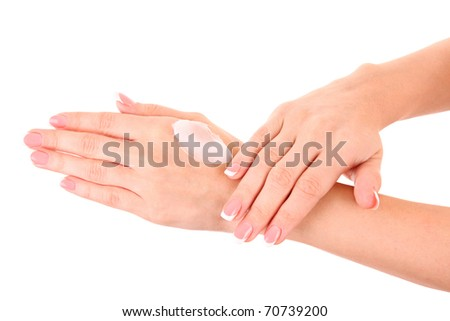 Closeup of beautiful female hands applying hand cream isolated on white background - stock photo