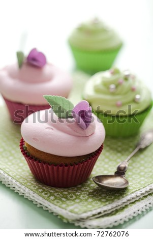 closeup of beautiful summer cupcake with strawberry flavoured cream - stock photo