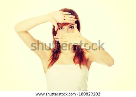 Closeup of beautiful teen woman making frame on her face with her hands