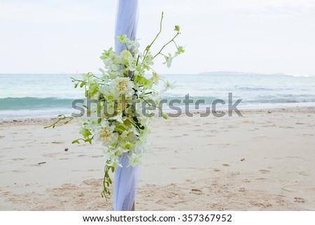 closeup of beautiful wedding decorated on beach wedding setup - stock photo