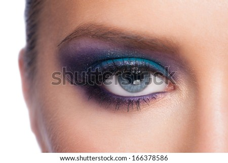 Closeup of beautiful woman eye with bright fancy colorful makeup  - stock photo