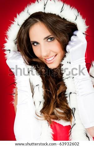 closeup of beautiful woman wearing santa claus clothes - stock photo