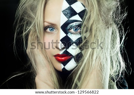 Closeup of beautiful woman with chess pattern on a half of  face - stock photo