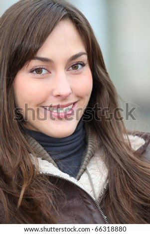 Closeup of beautiful woman with warm jacket in winter