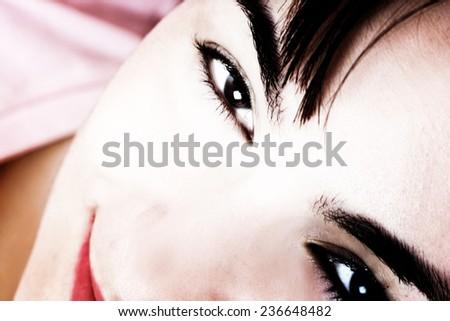 Closeup of beautiful young woman face. - stock photo