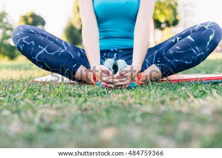 Closeup of beautiful young woman meditating in the park