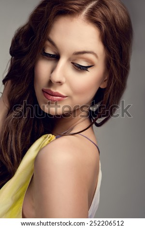 closeup of beautiful young woman with fresh spring look, wonderful hair, nice make-up, flower head band - stock photo