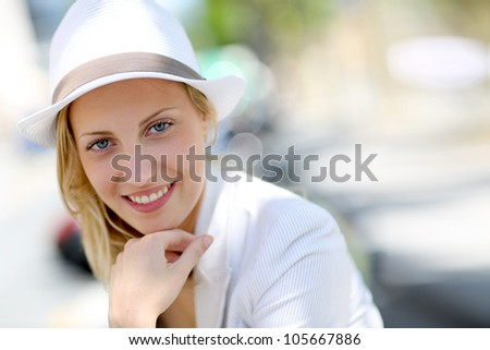 Closeup of beautiful young woman with hat - stock photo