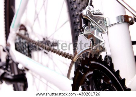 Closeup of bicycle chain and front derailleur.