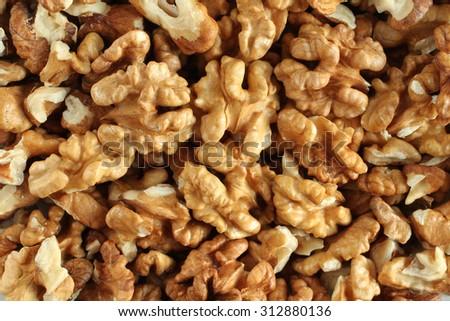 Closeup of big shelled walnuts pile - stock photo