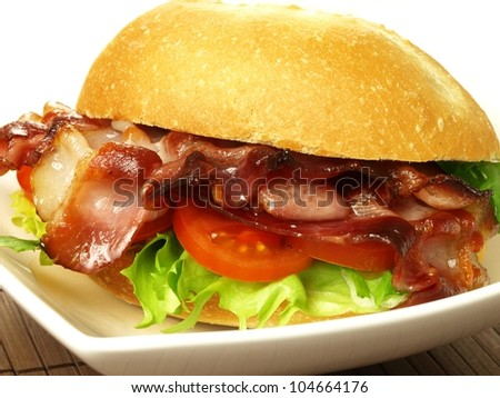 Closeup of big tasty sandwich with bacon - stock photo