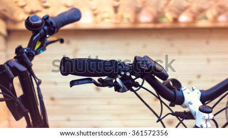 Closeup of bike handlebars - stock photo