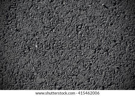 Closeup of black asphalt texture. Pavement background. - stock photo