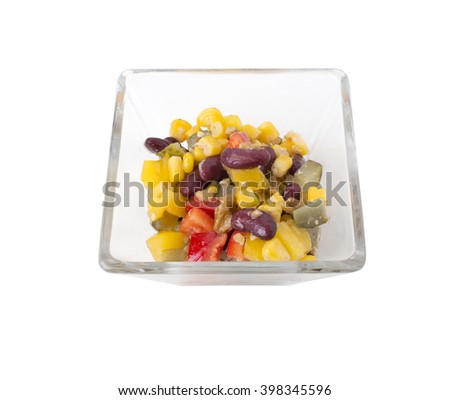 Closeup of black bean and corn salad in a glass plate. Isolated on a white background.   - stock photo