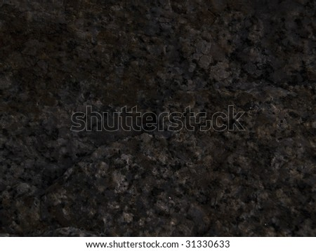 Closeup of black granite surface can be used for backgrounds or Web site wallpaper