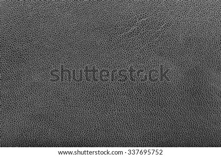 Closeup of black leather texture as background - stock photo